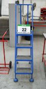 A 4-Tread Mobile Library Step Ladder