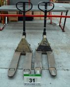 Two CROWN Compact Hydraulic Pallet Trucks