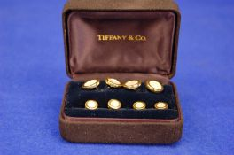 A TIFFANY & CO. 18ct Gold and Mother of Pearl Contemporary Dress Studs and matching Pair of Double