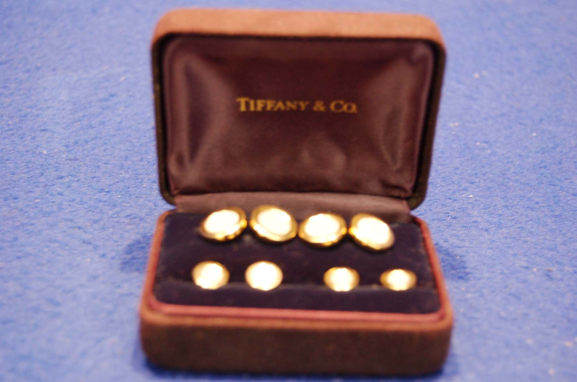 Lot 4 - A TIFFANY & CO. 18ct Gold and Mother of Pearl Contemporary Dress Studs and matching Pair of Double
