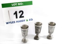 Three Pewter Commemorative Goblets of Conical Form on Column Stem with Fluted Base with Relief