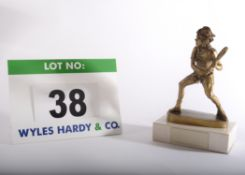 A Tennis Trophy having a Gold Coloured Resin Figure of a Tennis Player on a Composite Marble