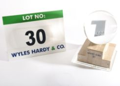 A Trophy in the form of a Clear Plastic Globe, approx. 150mm dia., containing a Cast Metal Plate