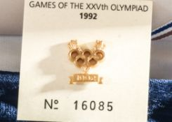 "A Gold Coloured Lapel Badge depicting the Olympic Rings and the Date 1992 Commemorating ""The Games"