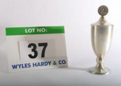 A Metal Trophy in the form of a Cup bearing the inscribed words Deutsche Jugendmeister 1982 Juniuren