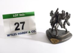 A Cast Bronze Trophy depicting Four Runners Stretching for the Finishing Line, Casting Mark 1975