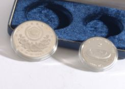 A Blue Protective Case containing Two Silver Coins (Proof Set) One bearing a Relief of a Women's