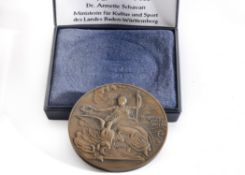 A 100 Year Commemorative Cast Metal Medal bearing a Relief of AOHNAI and the words OΛYPIAKOI ARΩ