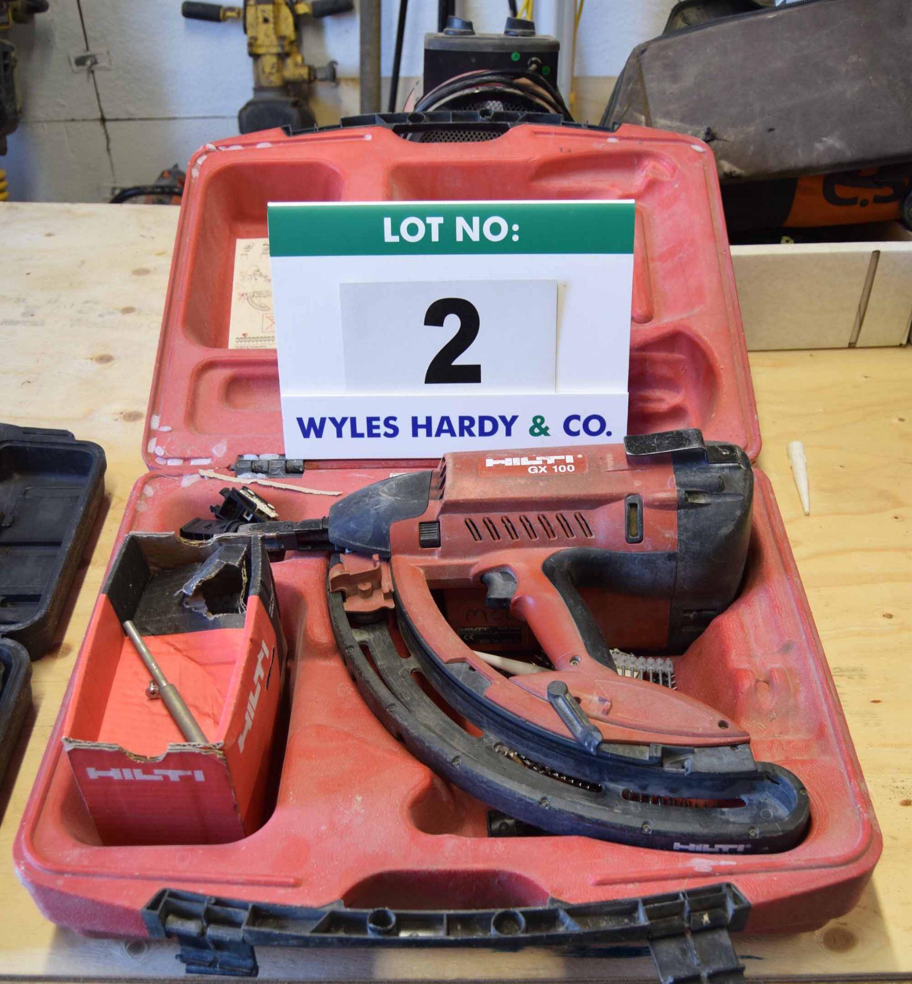 Lot 2 - A HILTI GX100 Gas Cartridge Powered Nail Gun in Rigid Plastic Carry/Storage Case