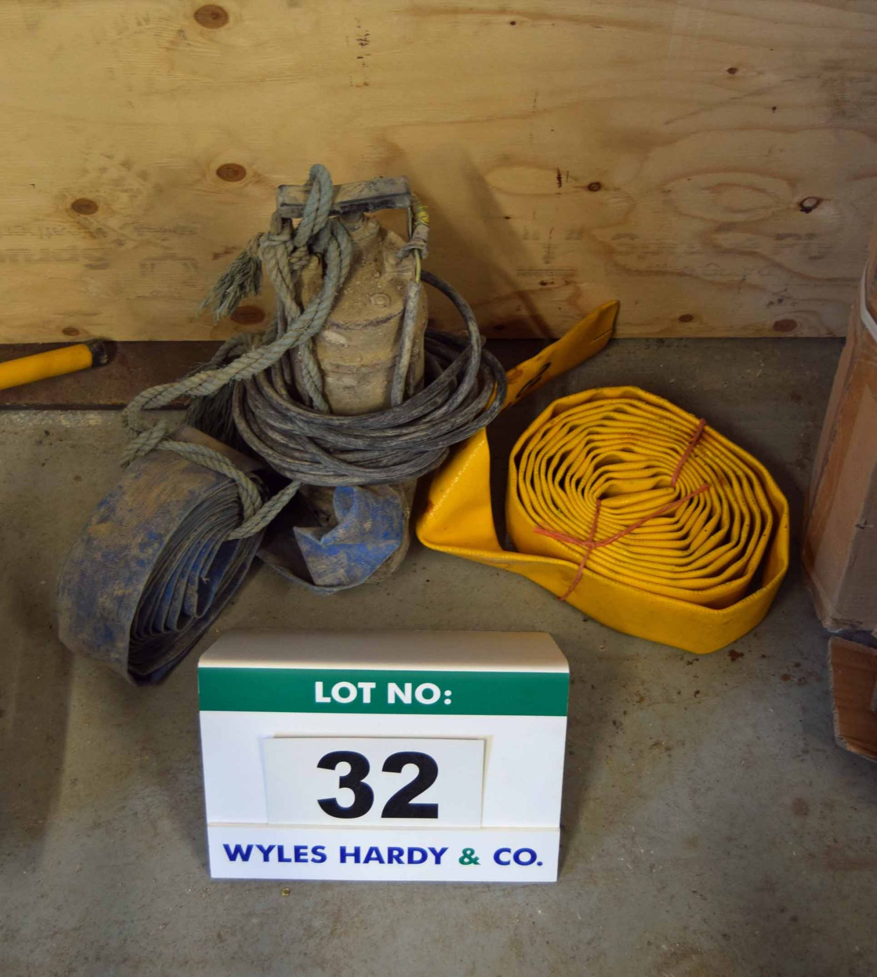 Lot 32 - A 110V Submersible Pump with Two Hoses