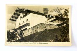 """Postkarte mit Signatur von Adolf HitlerPostkarte mit Foto, bez. """"Landhaus unseres Führers (Haus"""