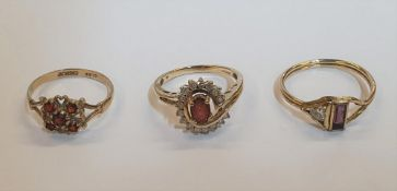 3 gold rings to include a 9ct yellow gold & oval cut Garnet surrounded by diamonds, another 9ct gold