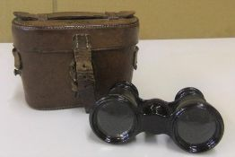 Unusual early 20thC Opera glasses in the form of conventional binoculars including the leather