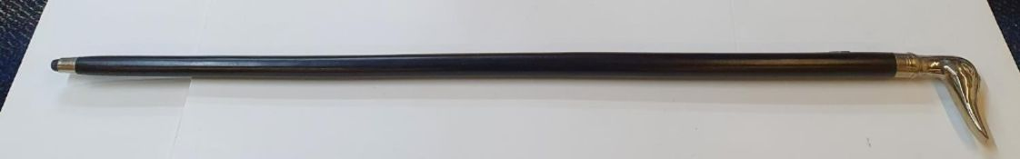 Ebonised wood walking stick with ducks head, unmarked white metal handle, 93 cm in length
