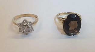 9ct yellow gold, large oval quartz ring together with a 9ct yellow gold, CZ cluster dress ring (