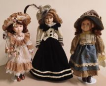 3 Windsor collection porcelain decorative large dolls in Victorian dress, all on metal stands,