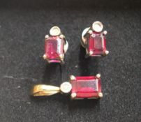 Art nouveau, matching set of earrings and pendant, all set with a baguette cut ruby below a circular