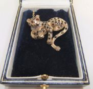 Stunning modernist 9ct gold brooch of a leopard studied with sapphires, diamonds and rubies Approx