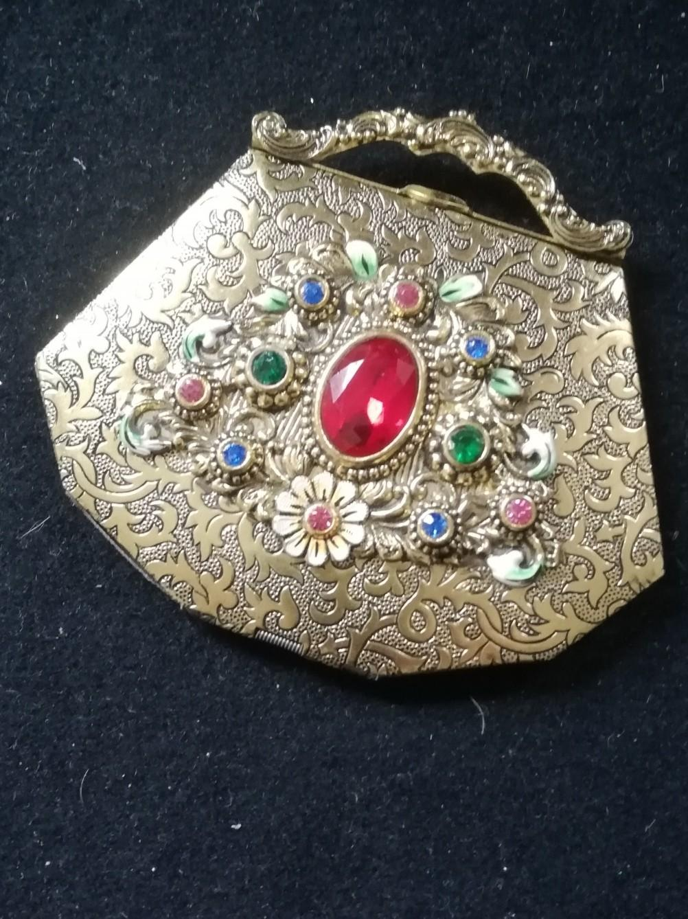 """Lot 127 - Compact in the form of a handbag with enamelled flowers and paste decoration 3¼"""" x 3"""""""
