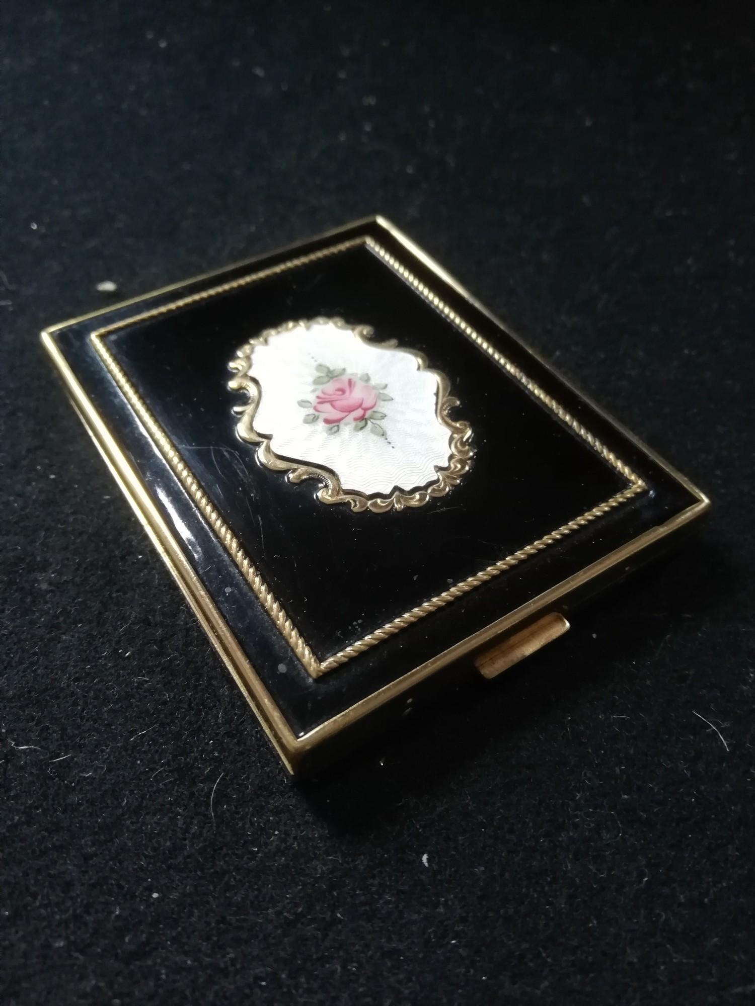 "Lot 125 - enamel and black fronted gilt metal compact 3"" x 2½"""