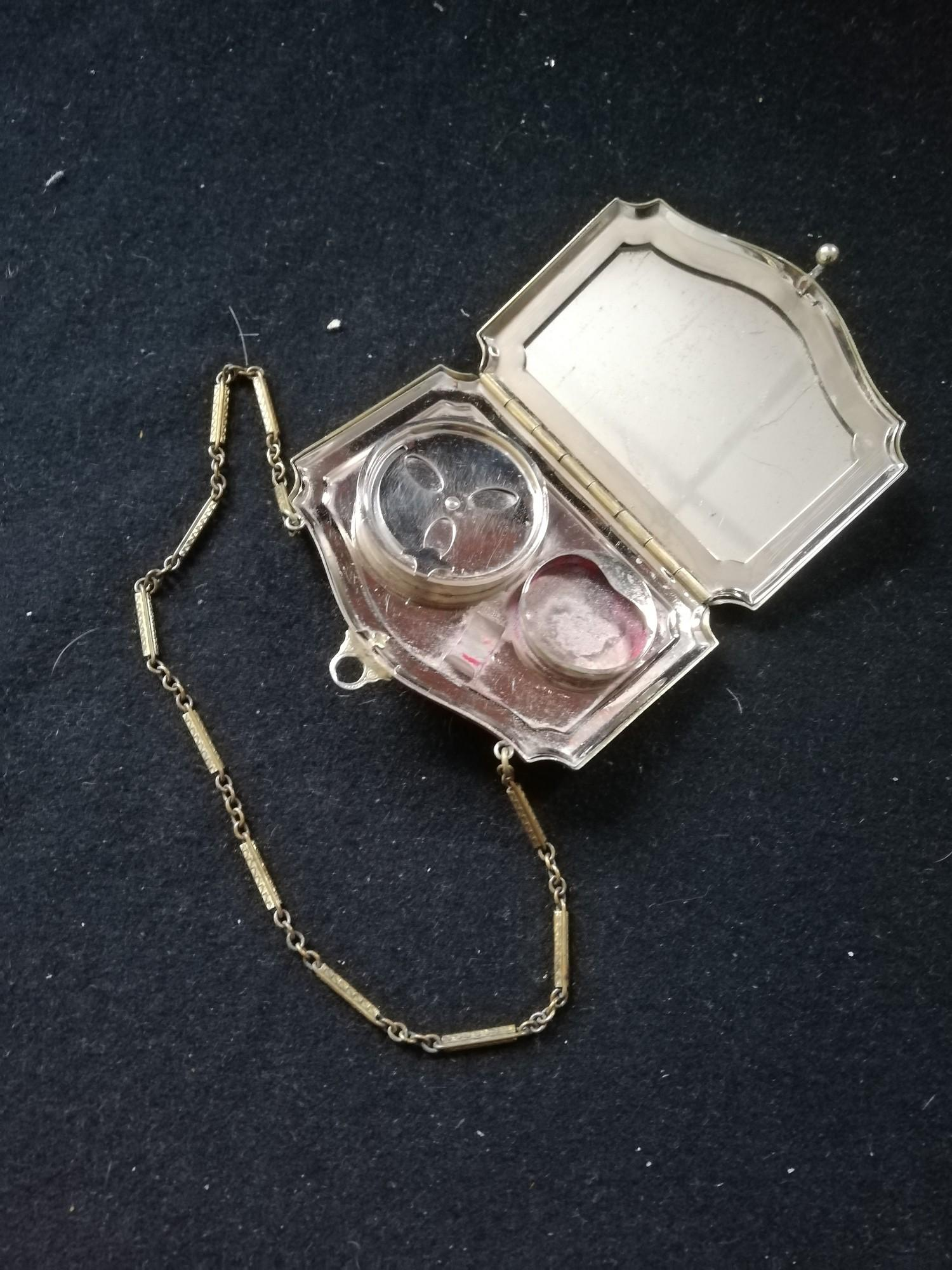 Lot 123 - 1930's American vanity case / compact designed as a bag with enamelled plaque to front