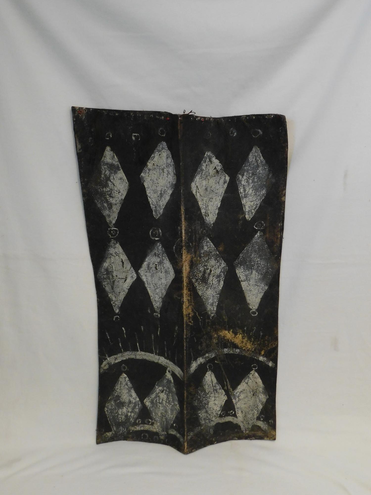 Lot 231 - Naga (India/Burma) headhunters hide shield with geometric paint decoration adorned with hair
