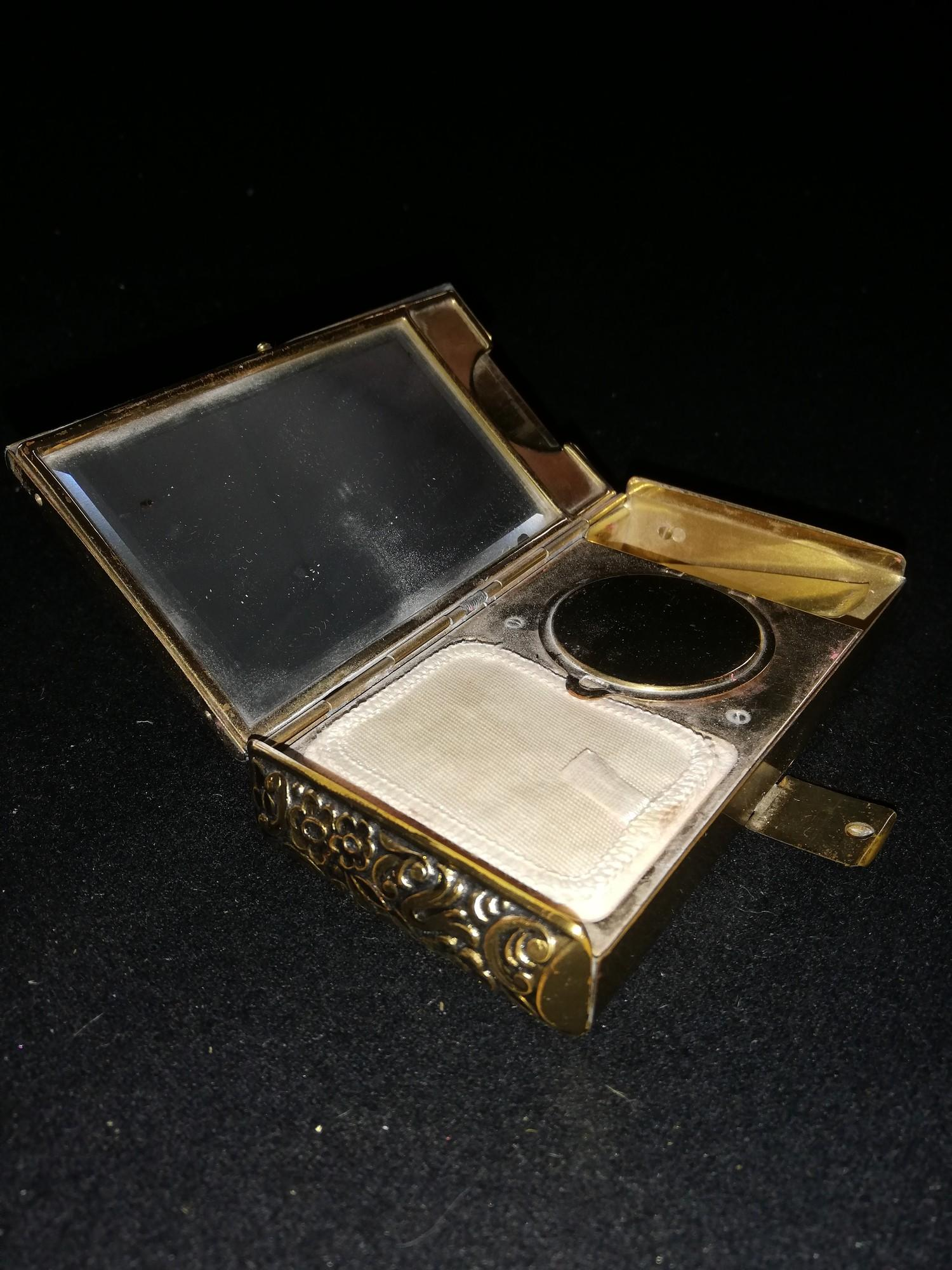 """Lot 131 - 1940's gilt metal vanity case with silver and green paste decoration 4½"""" x 2½"""""""