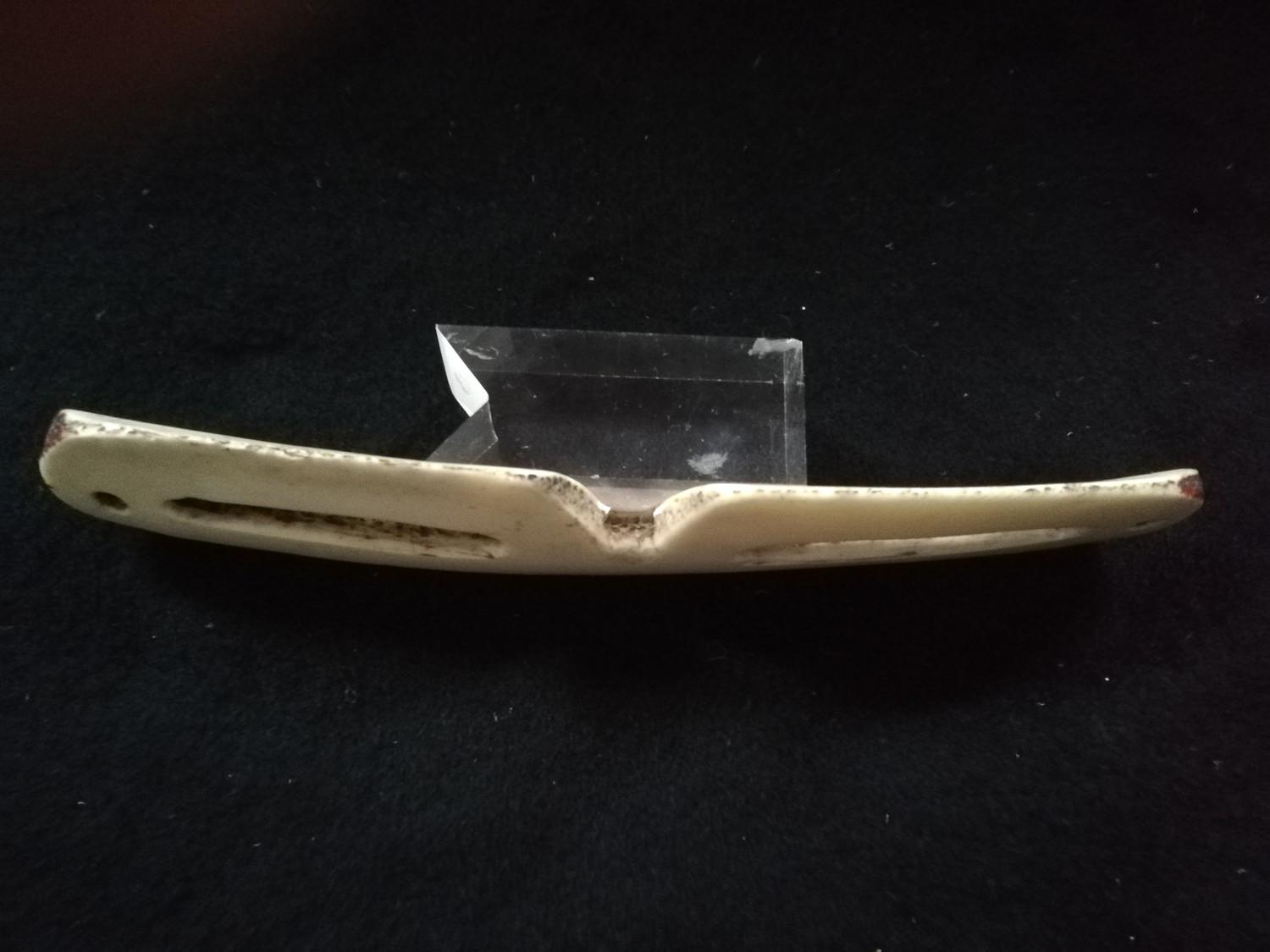 """Lot 241 - Inuit pair of snow goggles carved from bone -7"""" long"""