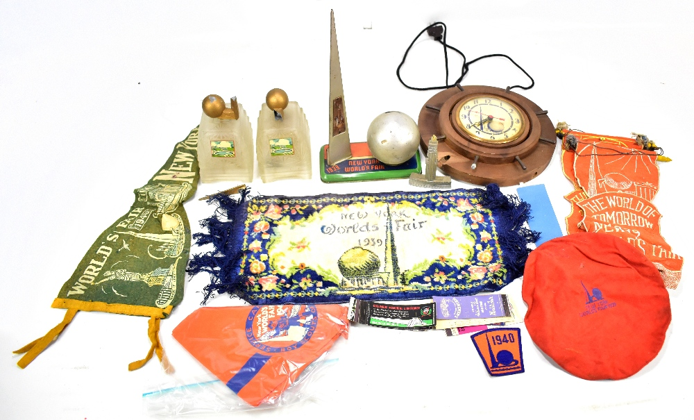Lot 17 - NEW YORK WORLD'S FAIR 1939; a quantity of collectors' items including a wall clock, two lamps, money