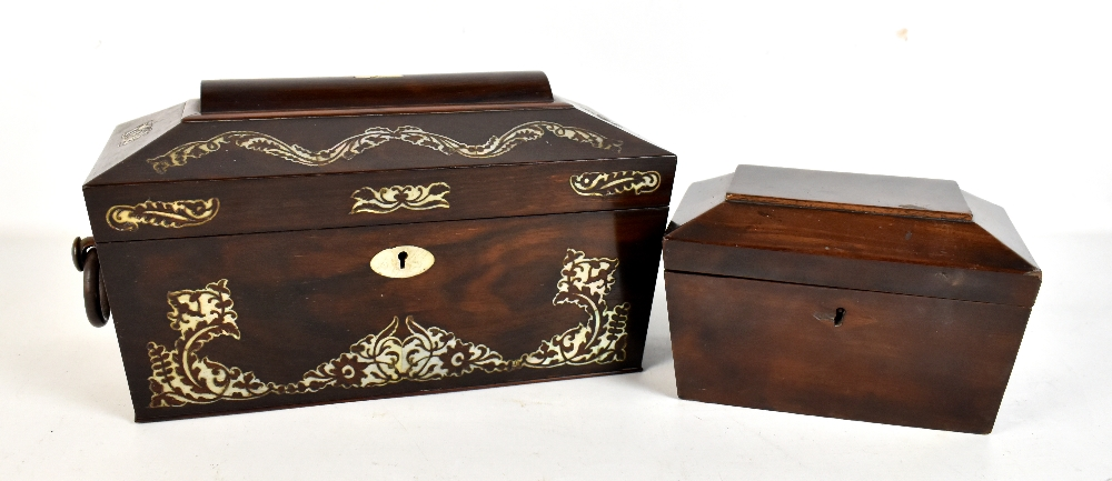 Lot 35 - A Victorian rosewood tea caddy with mother of pearl inlay, the hinged cover enclosing two