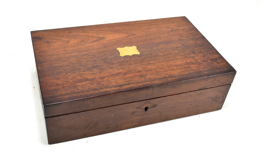 Lot 32 - A 19th century rosewood writing slope, the hinged cover enclosing slope and compartments, length