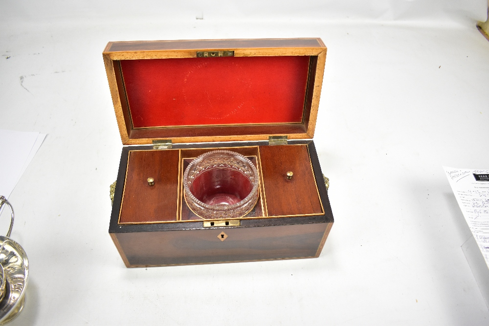 Lot 34 - A Regency rosewood, cross banded inlaid rectangular tea caddy with twin lion mask and loop