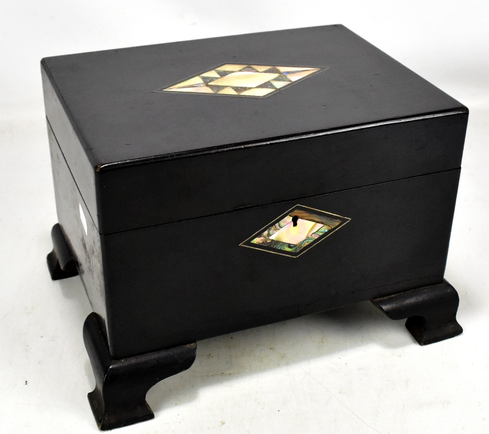Lot 43 - A black ebonised Victorian jewellery box with mother of pearl cartouche, on later feet, length