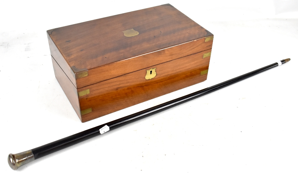 Lot 31 - A Victorian mahogany and brass bound writing slope with fitted interior including two glass