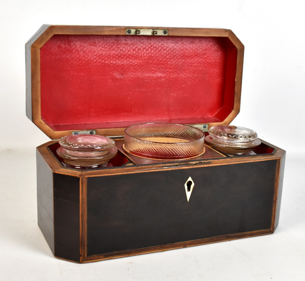 Lot 54 - A Georgian stained mahogany crossbanded tea caddy, the hinged cover enclosing two glass lidded