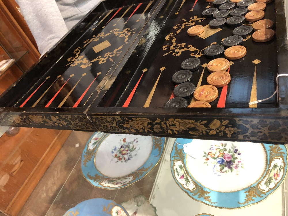 Lot 23 - A 19th century Chinese lacquered and gilt games box with chess board to lid and backgammon board