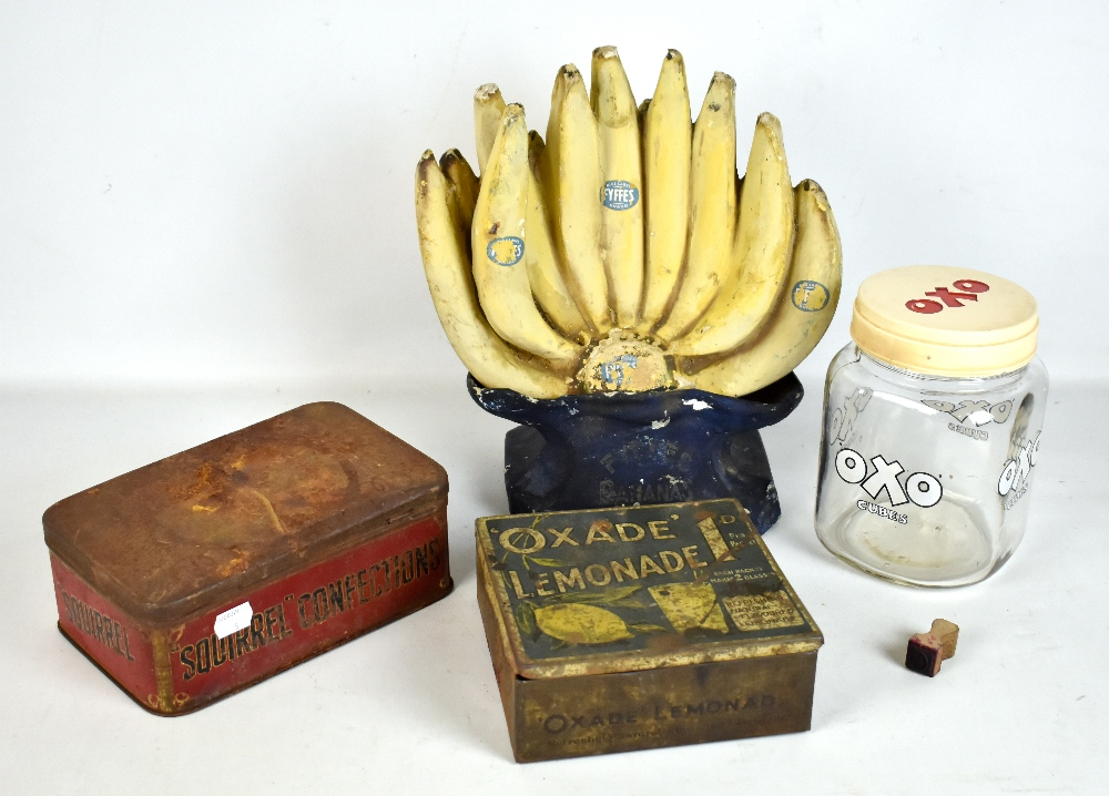 Lot 21 - Five pieces of assorted advertising including Fyffes display, height 32cm, Oxade Lemonade tin, OXO