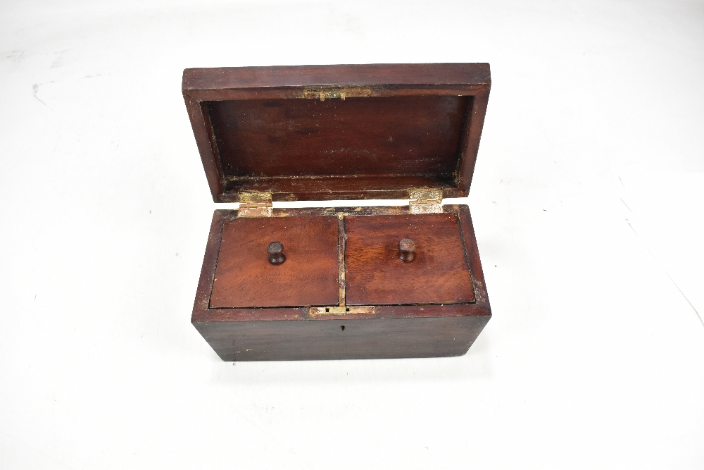 Lot 36 - A Victorian mahogany sarcophagus shaped two division tea caddy, length 24cm.