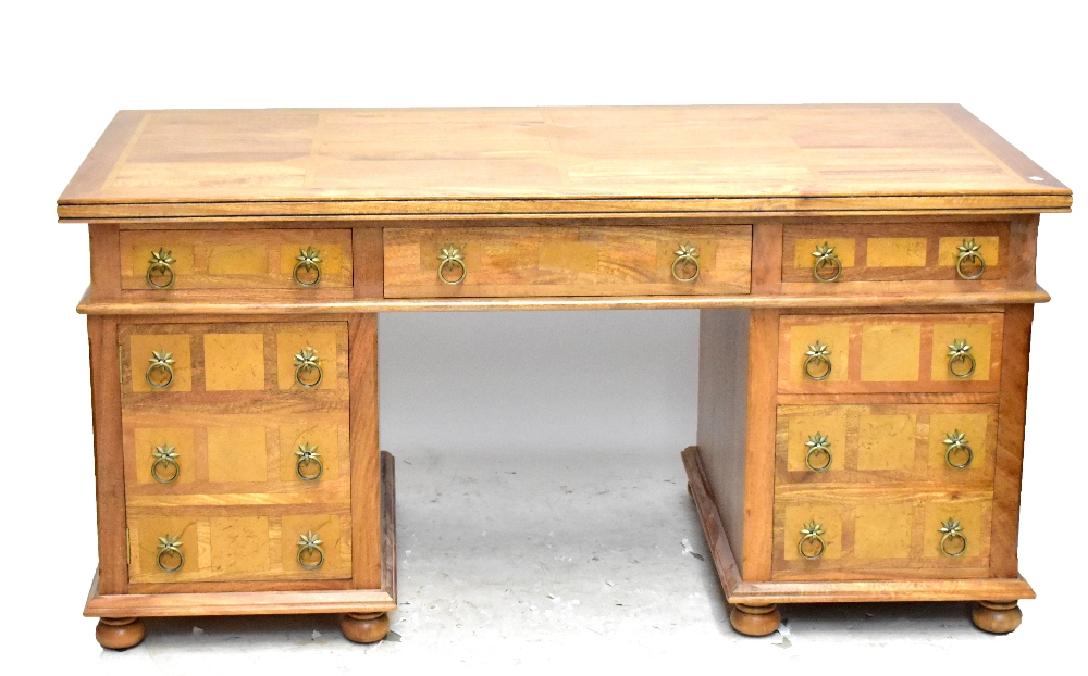 Lot 2729 - A modern hardwood pedestal desk with stone panel inlay, six draws and one cupboard, width 165cm.