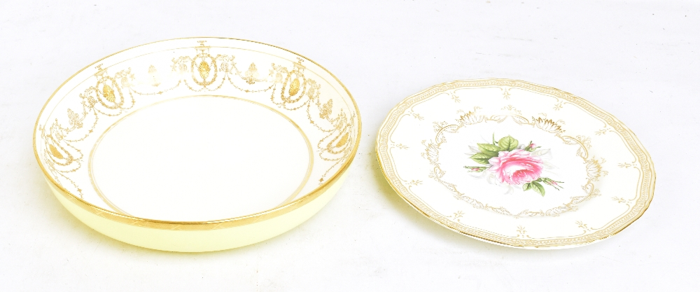 Lot 1192 - ROBERTS FOR ROYAL WORCESTER; a hand painted cabinet plate with central floral detail surrounded by a
