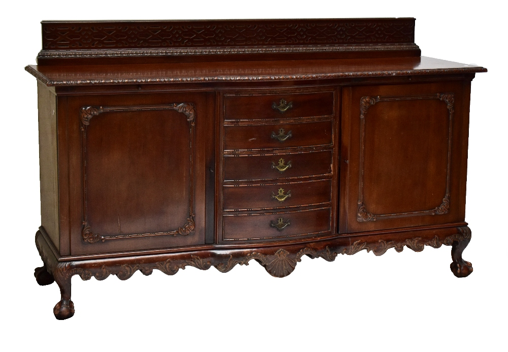 Lot 2727 - A large Continental bowfronted mahogany sideboard, with fretwork gallery above twin cupboard doors