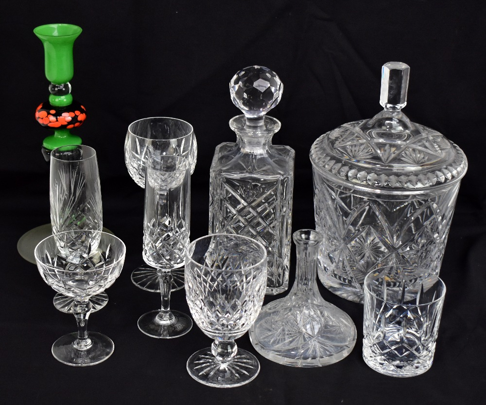 Lot 574 - A group of clear cut and moulded glass tableware including ice pail, five decanters including ship