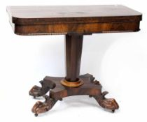 An early Victorian rosewood card table, central tapering column support to four ball and claw feet,