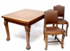 An early/mid-20th century oak dining suite comprising draw leaf table to Oriental style legs,