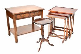 A reproduction nest of three tables on turned legs,