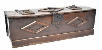 An 18th century oak salt box with applied geometric motifs, with iron fittings and interior shelf,