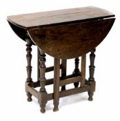 A small oak gateleg dropleaf table on baluster legs with stretchers, height 70cm, width 68.5cm.