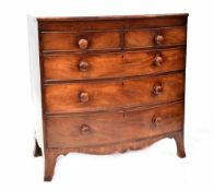 A 19th century bow-fronted mahogany chest of two short over three long graduated drawers with