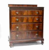 An early 20th century mahogany chest of four drawers,