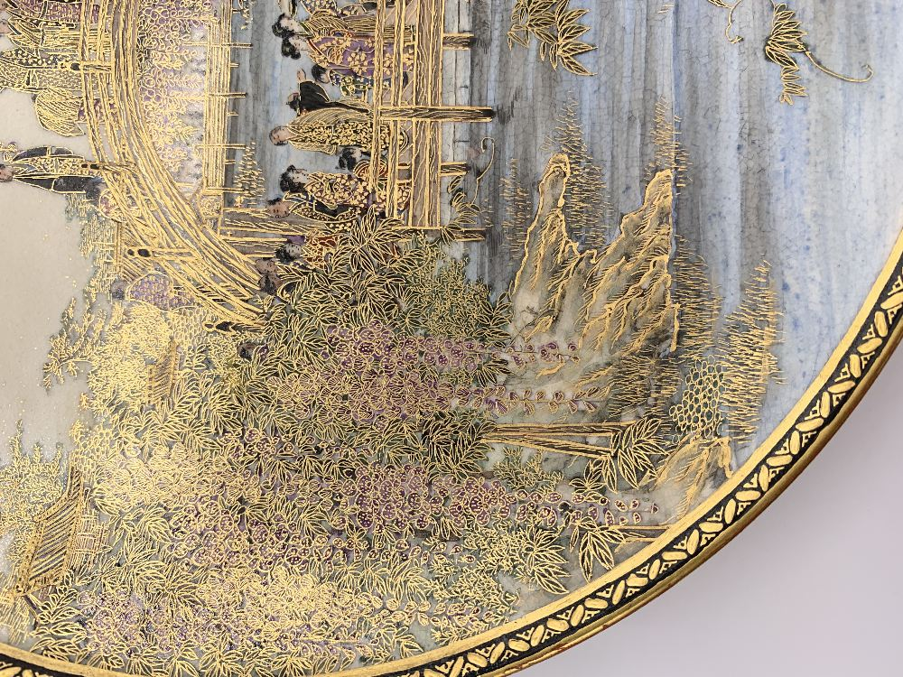 A fine Japanese Meiji period Satsuma plate decorated with figures on a bridge within cascades of - Image 4 of 8